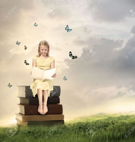 18006845-little-blonde-girl-reading-a-book-on-top-of-books-stock-photo